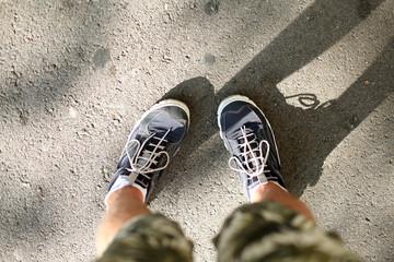 Men's feet in sneakers