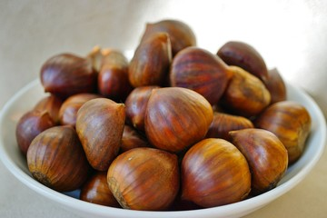 Bowl of fresh Italian chestnuts in the shell in winter