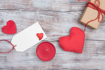 Red heart, candle, blank tag and gift for Valentines Day