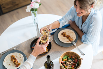 couple toasting with wine and havving dinner