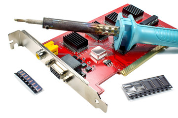 DVR motherboard with a soldering iron and repair parts on a white background