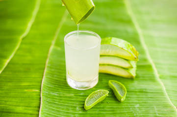 Aloe vera pieces on the background of banana leaf. Organic cosmetics concept