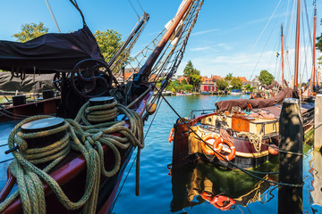 Ancient sailing ships on the Dutch river Vecht