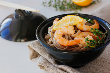 Soba with roasted shrimps in bowl