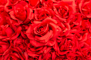Bouquet red artificial roses for background.