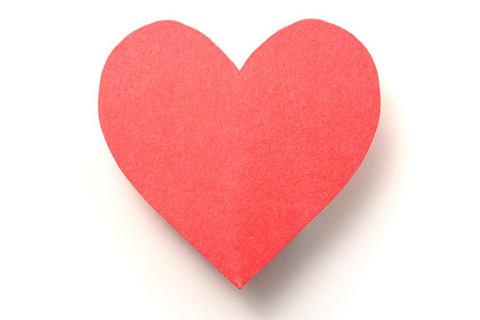 Red paper heart on white with shadow