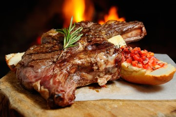 Garden Poster Steakhouse delicious piece of meat roasted on a background of fire