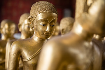 row of lady monk statues made from brass