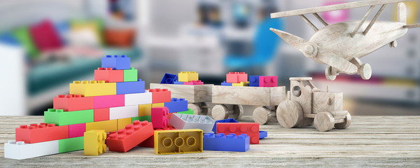 Plastic building blocks,plane and blur background