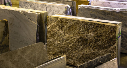 colorful samples of marble and granite counters in shop. the most popular choices for modern kitchen and bathroom remodeling.