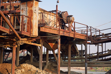 Old stone crushing plant. Gravel mill