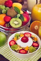 Healthy breakfast - muesli, yogurt, honey and fruits