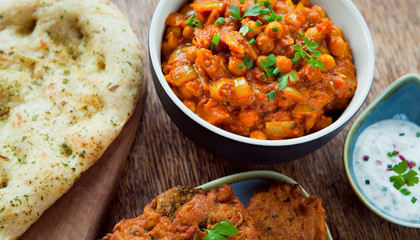 Chana Masala with Naan Bread and Raita - Indian chickpeas Curry.