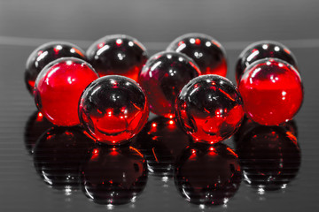 red balls on black glass surface