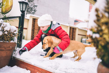 Girl with dog in snow