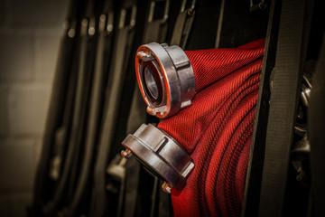 HDR - Feuerwehrequipment Feuerwehrschlauch aufgerollt mit Anschlüssen