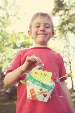 Young boy with a mother's day gift