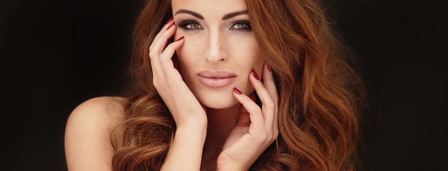 Golden portrait of beautiful woman.