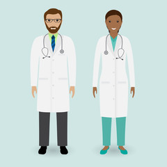 Hospital staff concept. Couple of man and woman doctors standing together.