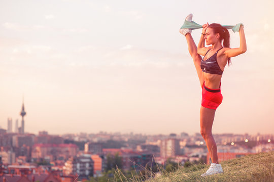 athletic woman working out in the city park