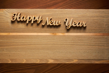 Happy New Year!/Happy New Year! - A phrase with wooden letters on a wooden backg