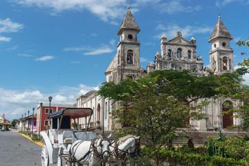 Granada, Nicaragua – December 21, 2016: Guadalupe Church view with la Calzada, the most touristic street in Nicaragua