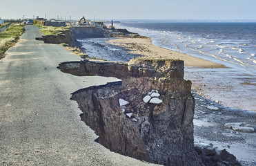 Coastal erosion of the cliffs at Skipsea, Yorkshire Wall mural