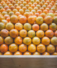 Stack of Oranges on Fruit Shelf Stand with Wood for Copy Space a