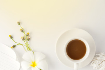 coffee with flower on white office table.
