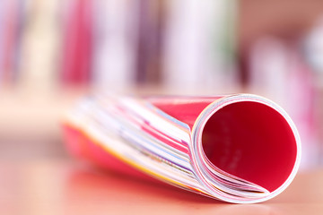 Close up edge of colorful magazine stacking roll