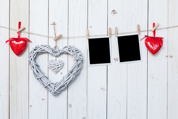 wooden rustic decorative hearts and photo frame hanging on vinta