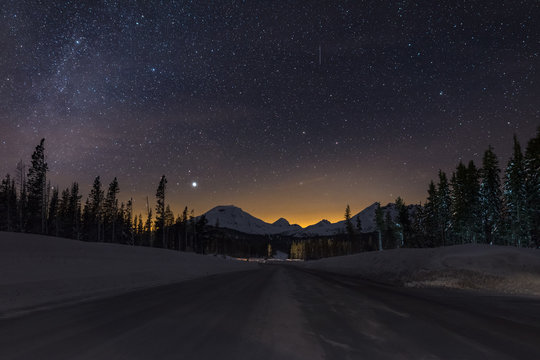 Oregon Cascade Mountain Wonderland Cascade Lakes Scenic Byway, Oregon Clear and cold magical high mountain night sky with four cascade volcanic peaks
