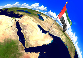 United Arab Emirates national flag marking the country location on world map. 3D rendering, parts of this image furnished by NASA