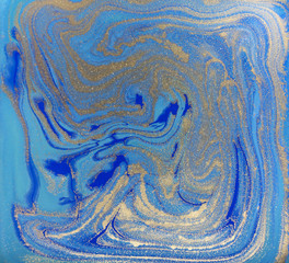 Blue and golden marbled liquid texture