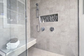 Glass walk-in shower in a bathroom of brand new home