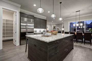 Modern gray kitchen features dark gray cabinetry