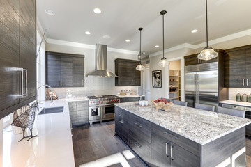 Modern gray kitchen features dark gray flat front cabinets