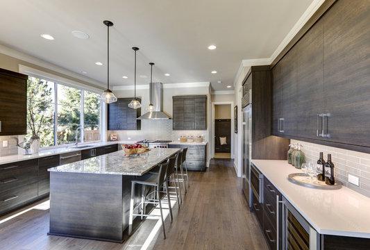 Modern gray kitchen features dark gray flat front cabinets