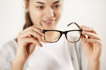 Woman hands holding eyeglasses
