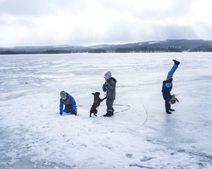 Children playing on ice