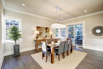 Lovely dining room with rectangular table and grey chairs