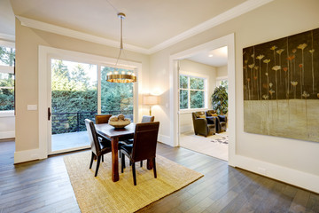 Open dining space design with soft beige walls
