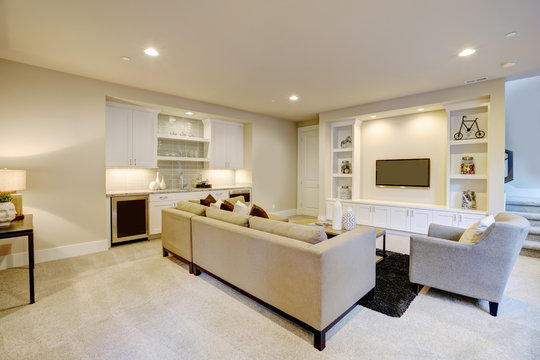Chic basement living room with wet bar