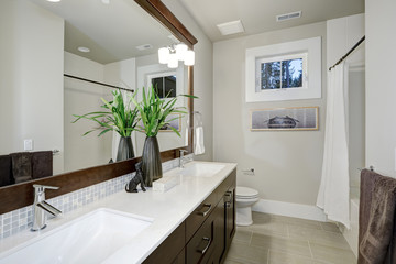 White and brown bathroom design in brand-new home