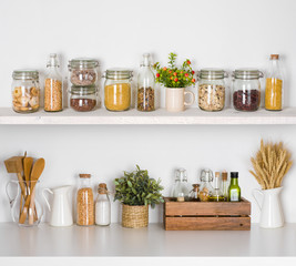 Modern kitchen shelves with various food ingredients on white background