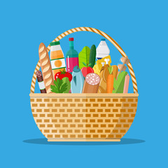 wicker basket full of groceries products