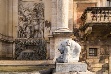 Rome, Italy. Detail of Fountain Acqua Felice (Moses Fountain) with a relief depicting scenes from the Bible, 1587 Egyptian lion with the name of the Pharaoh Nectanebo I, IV BC.
