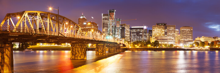 Skyline of Portland, Oregon across river, at night