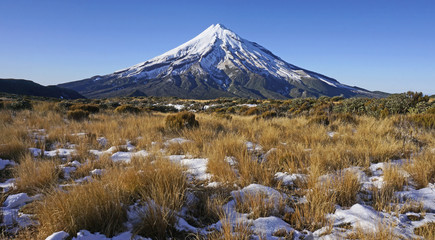 Mount Taranaki covered in snow on the north island of New Zealand.