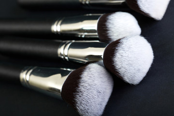Brush with natural bristles for professional makeup, closeup, co